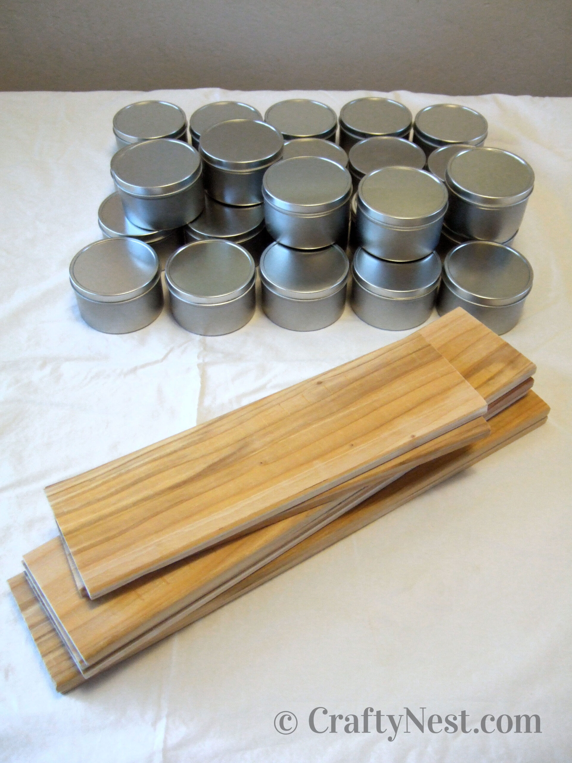 Cut pieces of wood and stack of tins, photo
