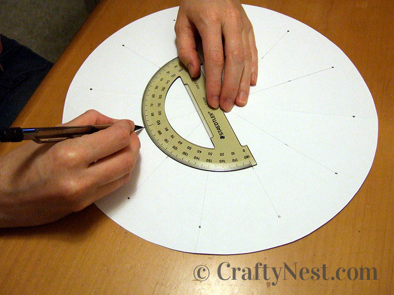 Using a protractor to mark where the nails go, photo