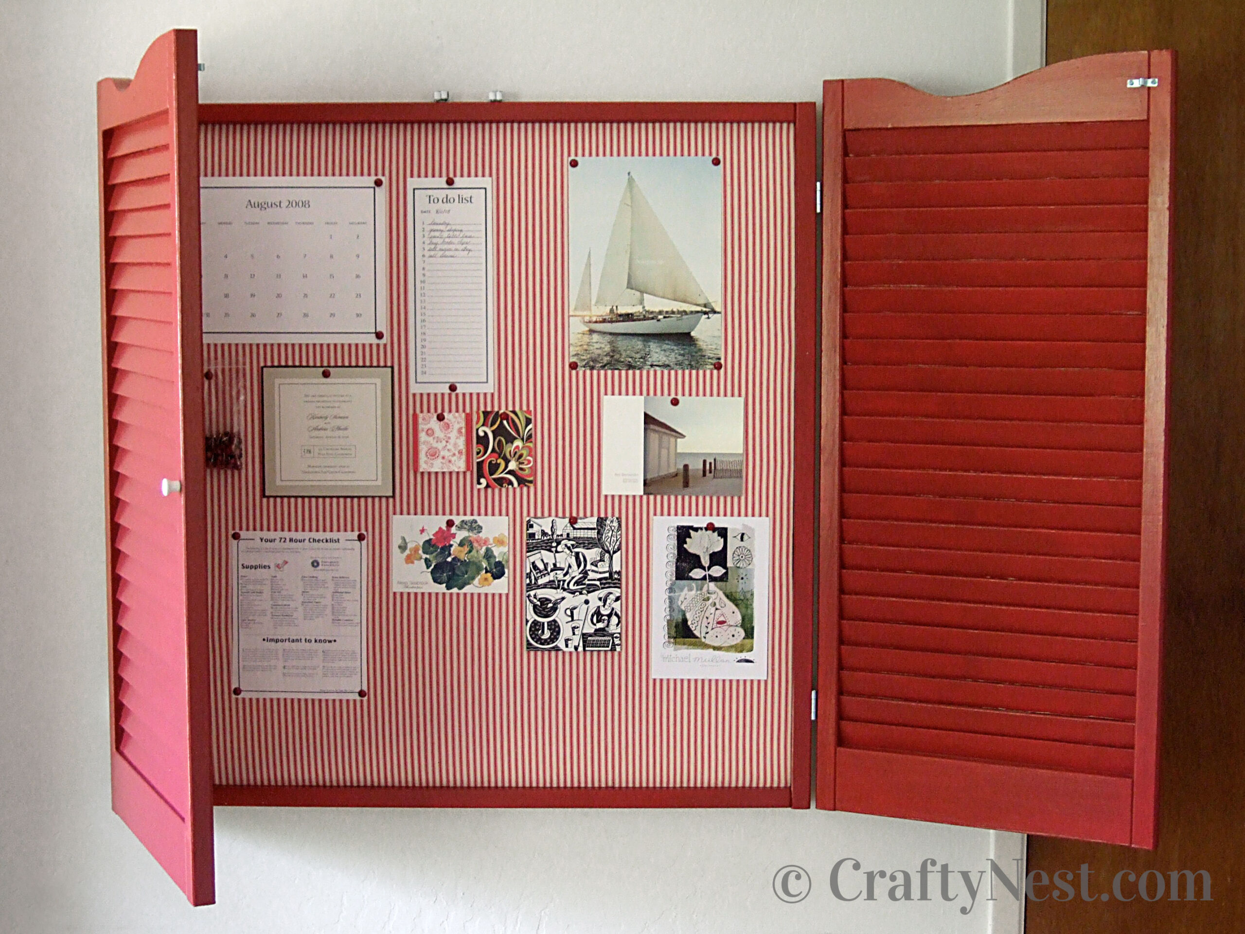Fabric-covered bulletin board with shutters, photo