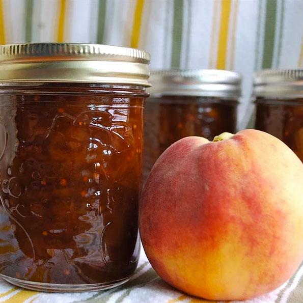 Jars of spicy peach chutney, photo