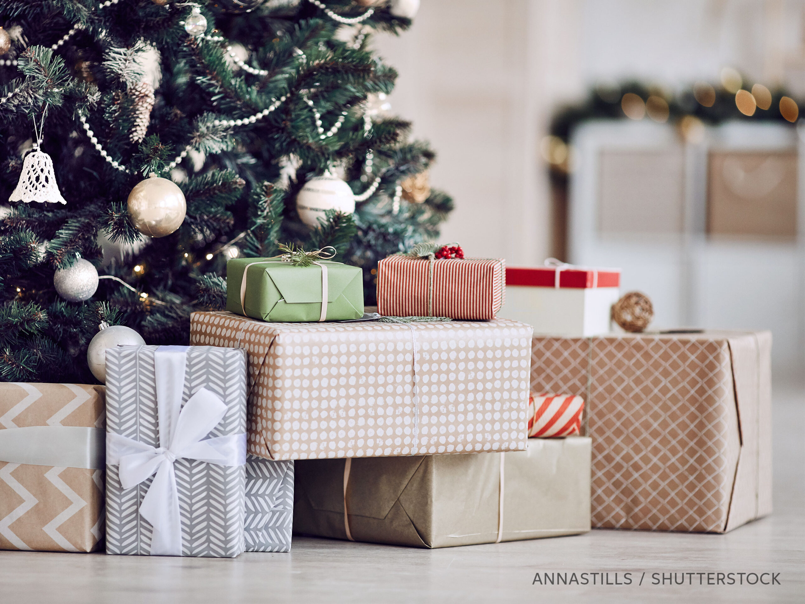 Wrapped gifts under a Christmas tree, photo