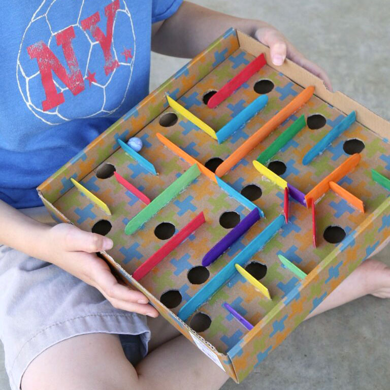 Cardboard box marble labyrinth game, photo