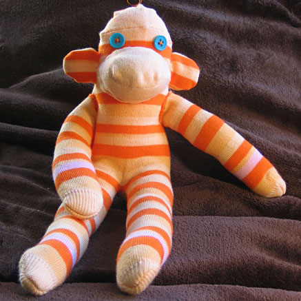 Orange striped sock monkey, photo