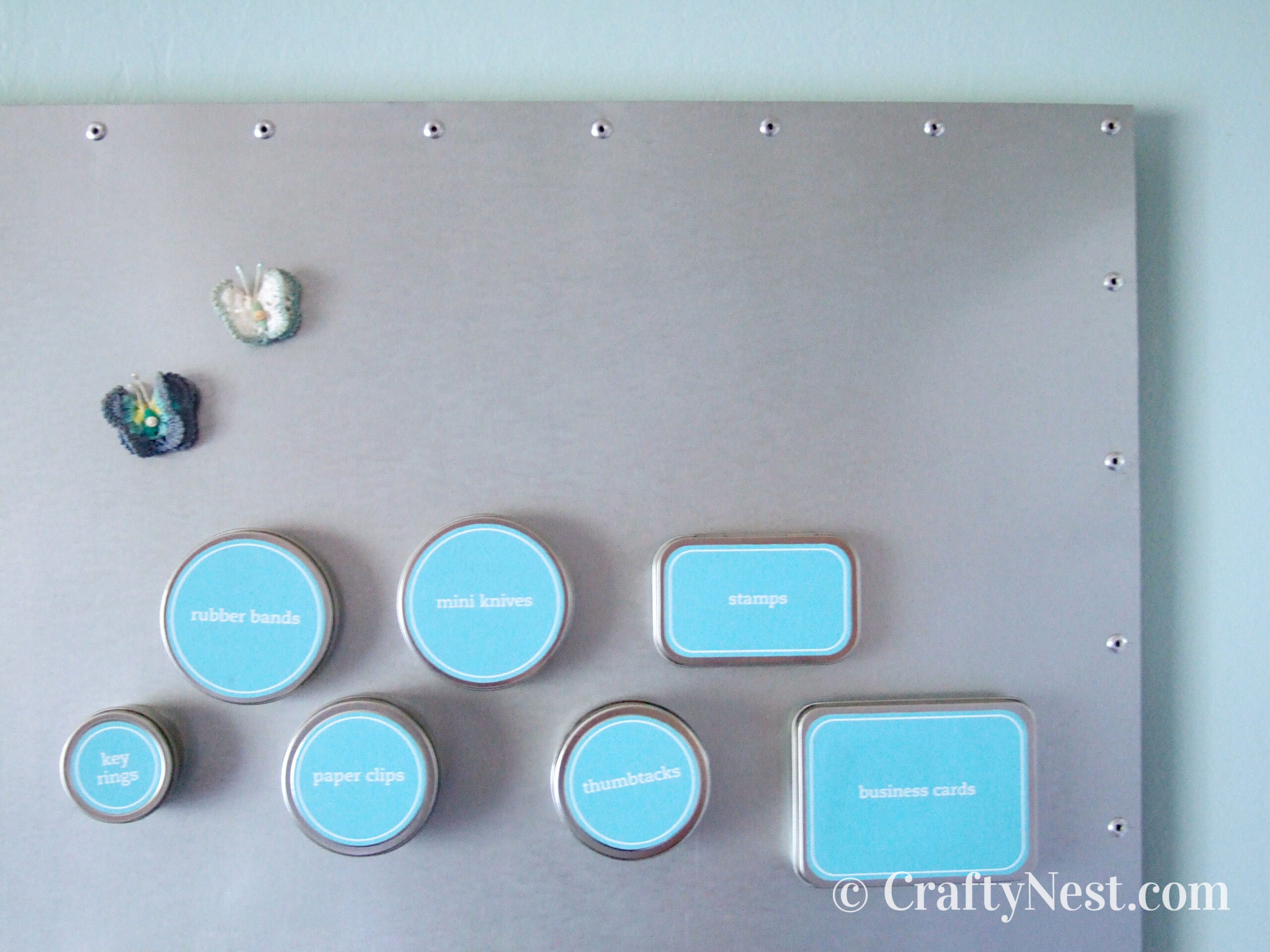 Magnetic tins on bulletin board, photo