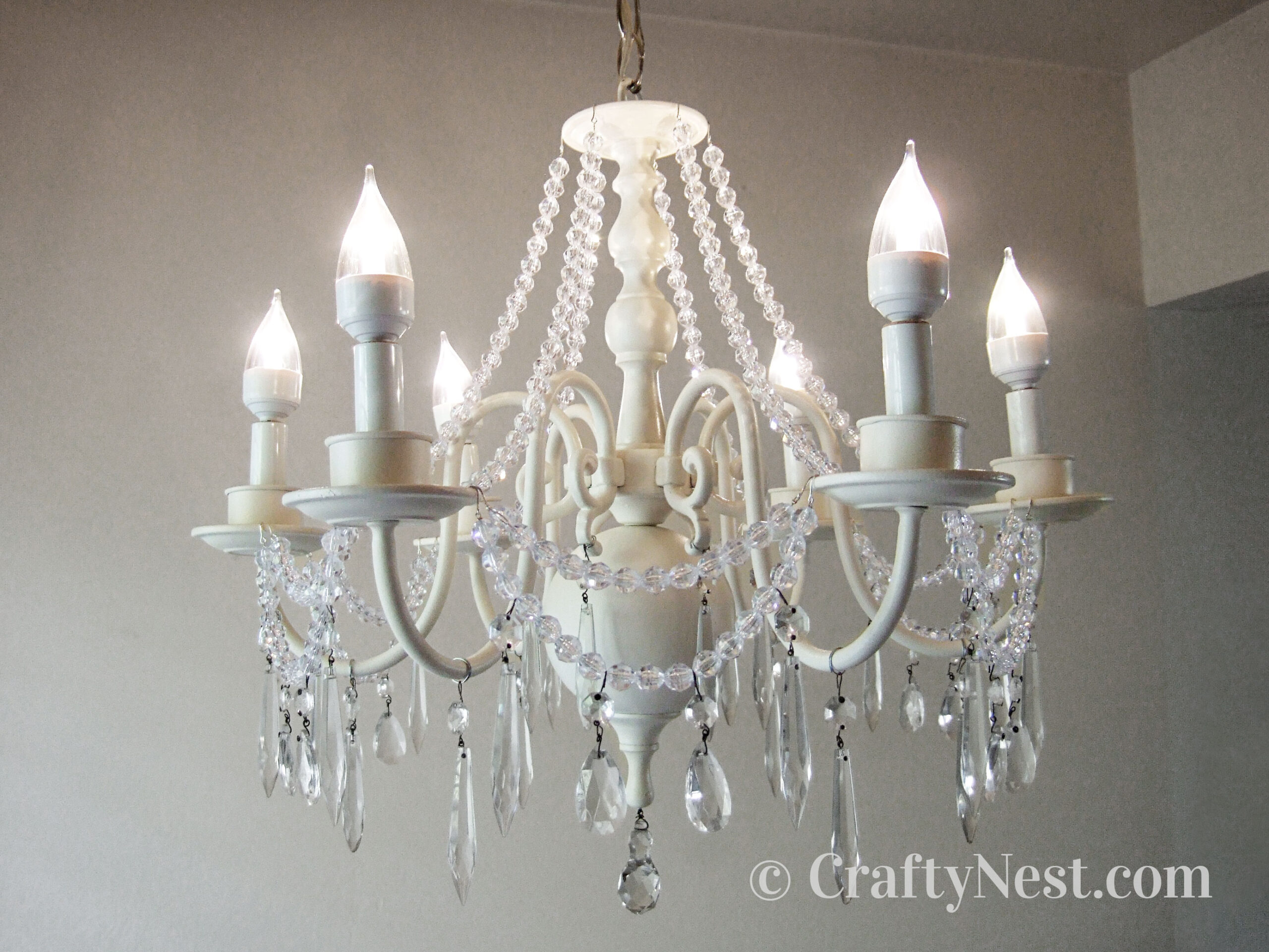 White chandelier with crystals, photo