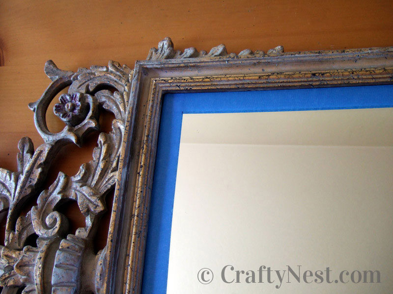 Painter's tape along the outside edge of the mirror, photo