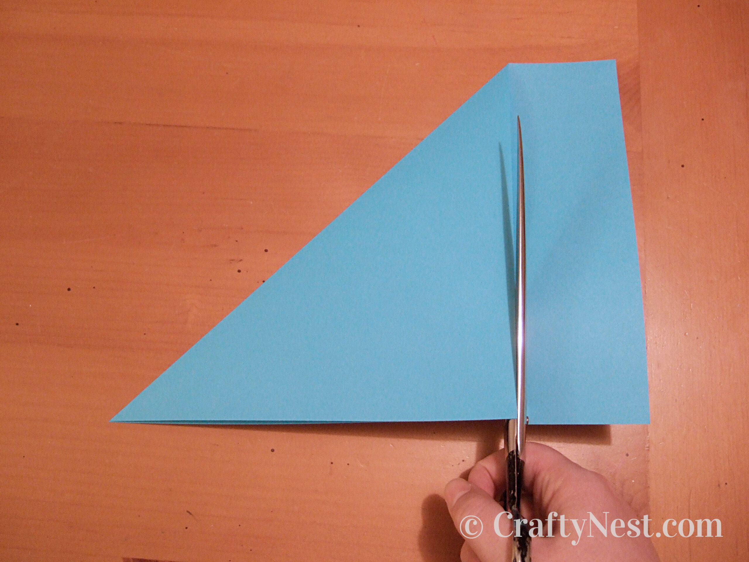 Cutting paper into a square, photo