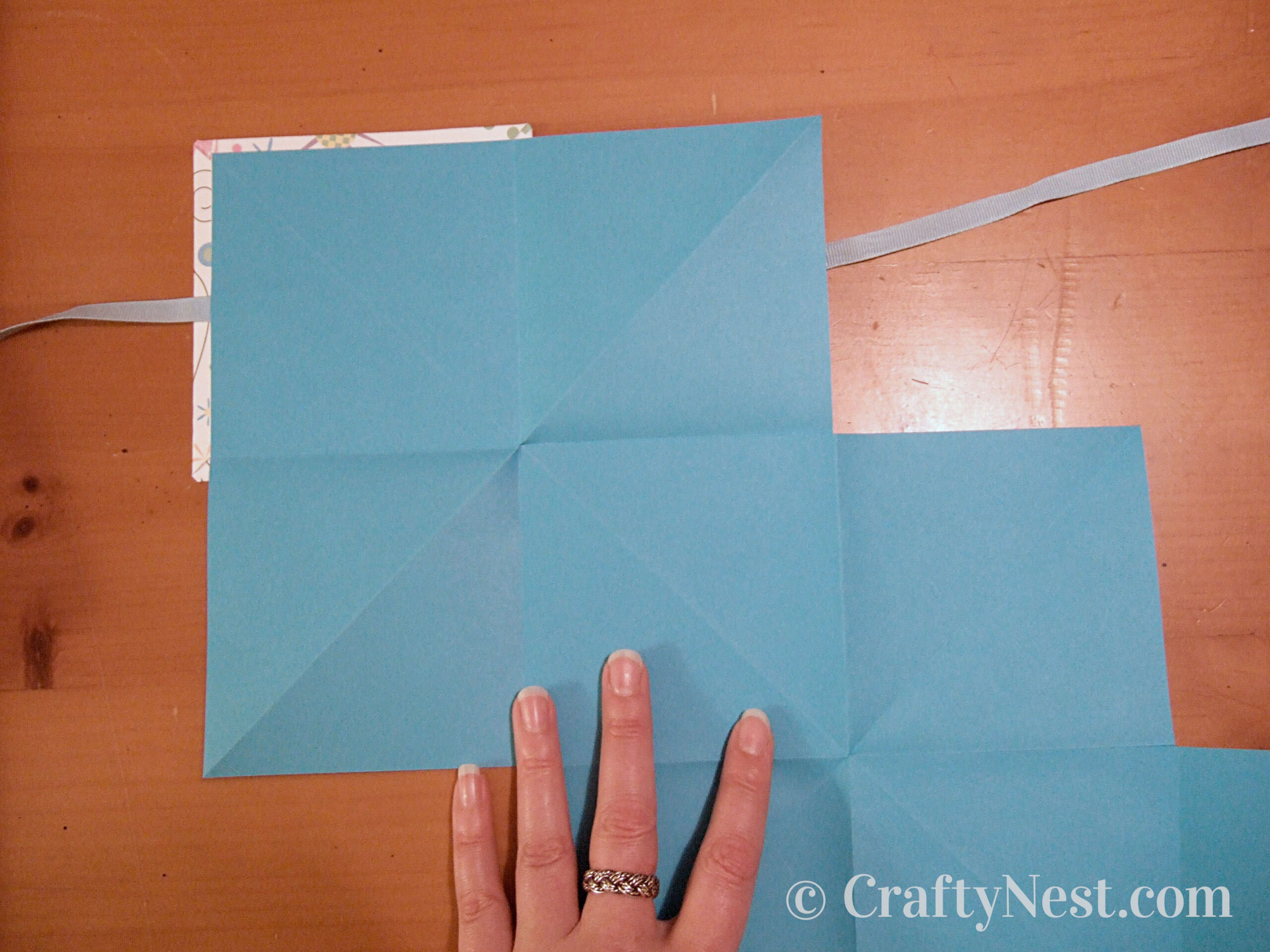 Glue pages onto inside of front cover, photo