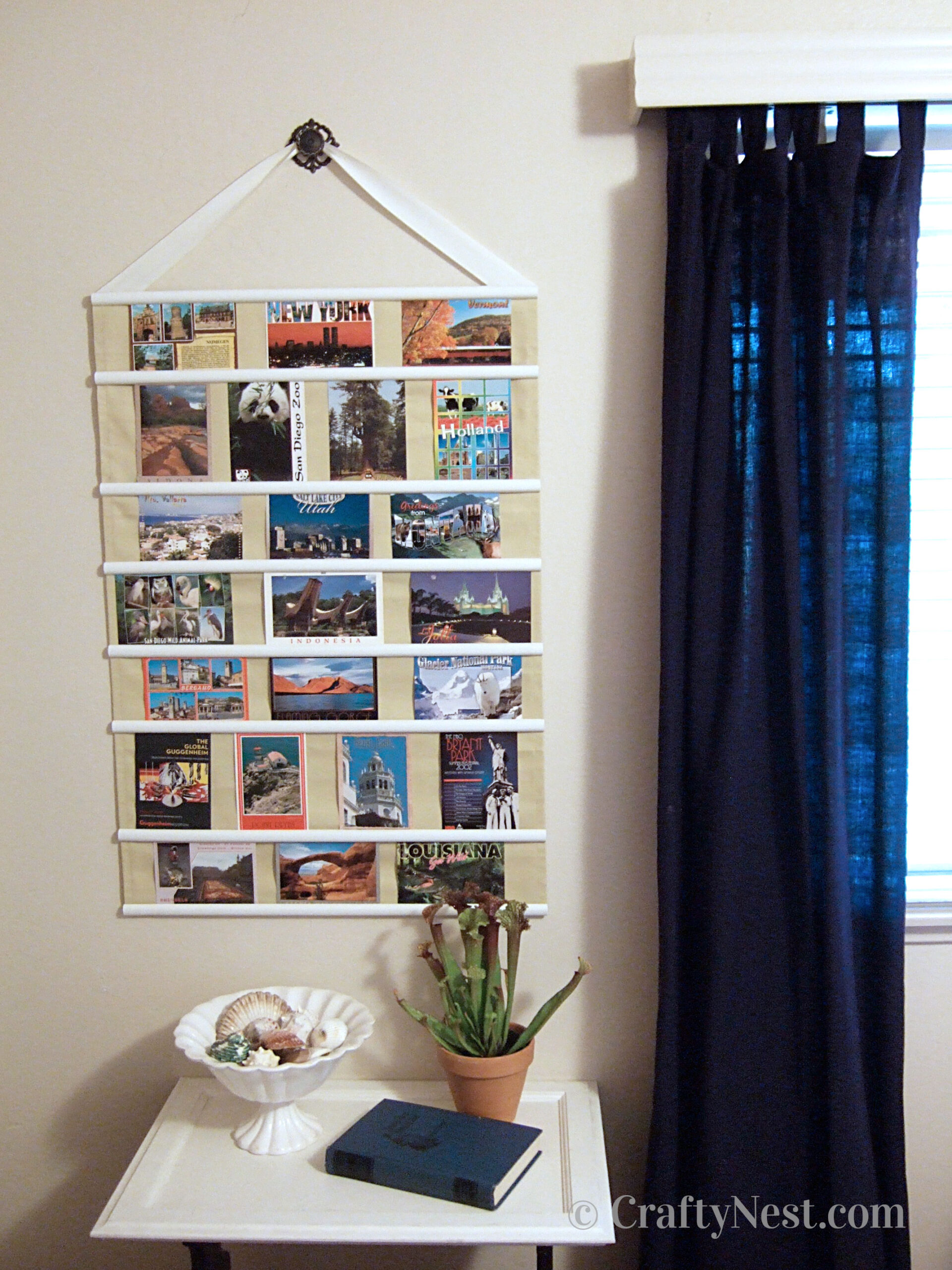 Postcards on a hanging fabric frame, photo