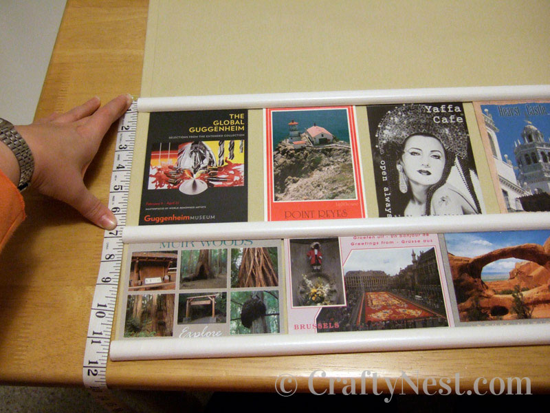 Measuring the second row of postcards, photo