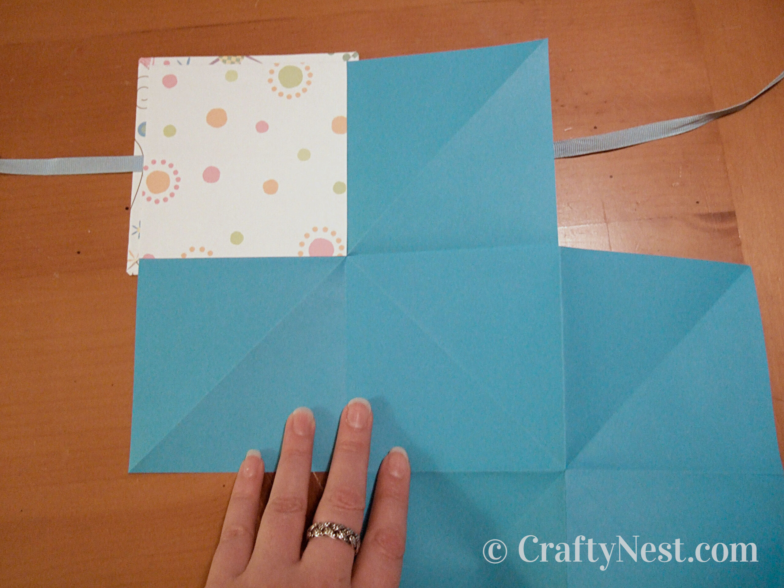 Glue decorative paper to inside of front cover, photo