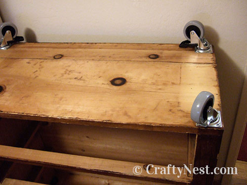 Casters attached to bottom of dresser, photo