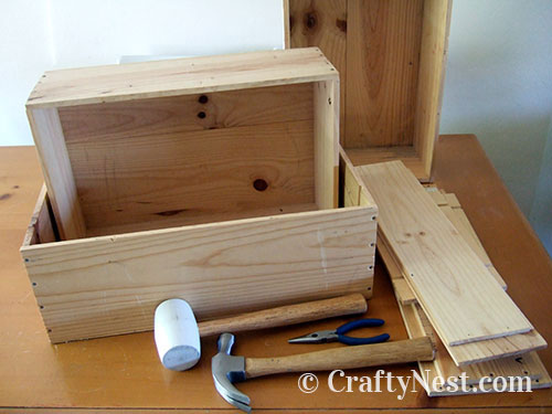 Disassembling a wooden wine box, photo