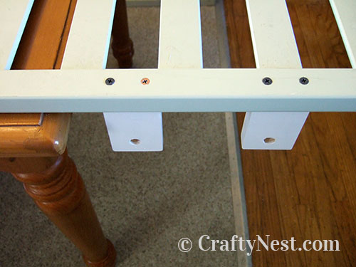 Attach dowel holders to railing, photo