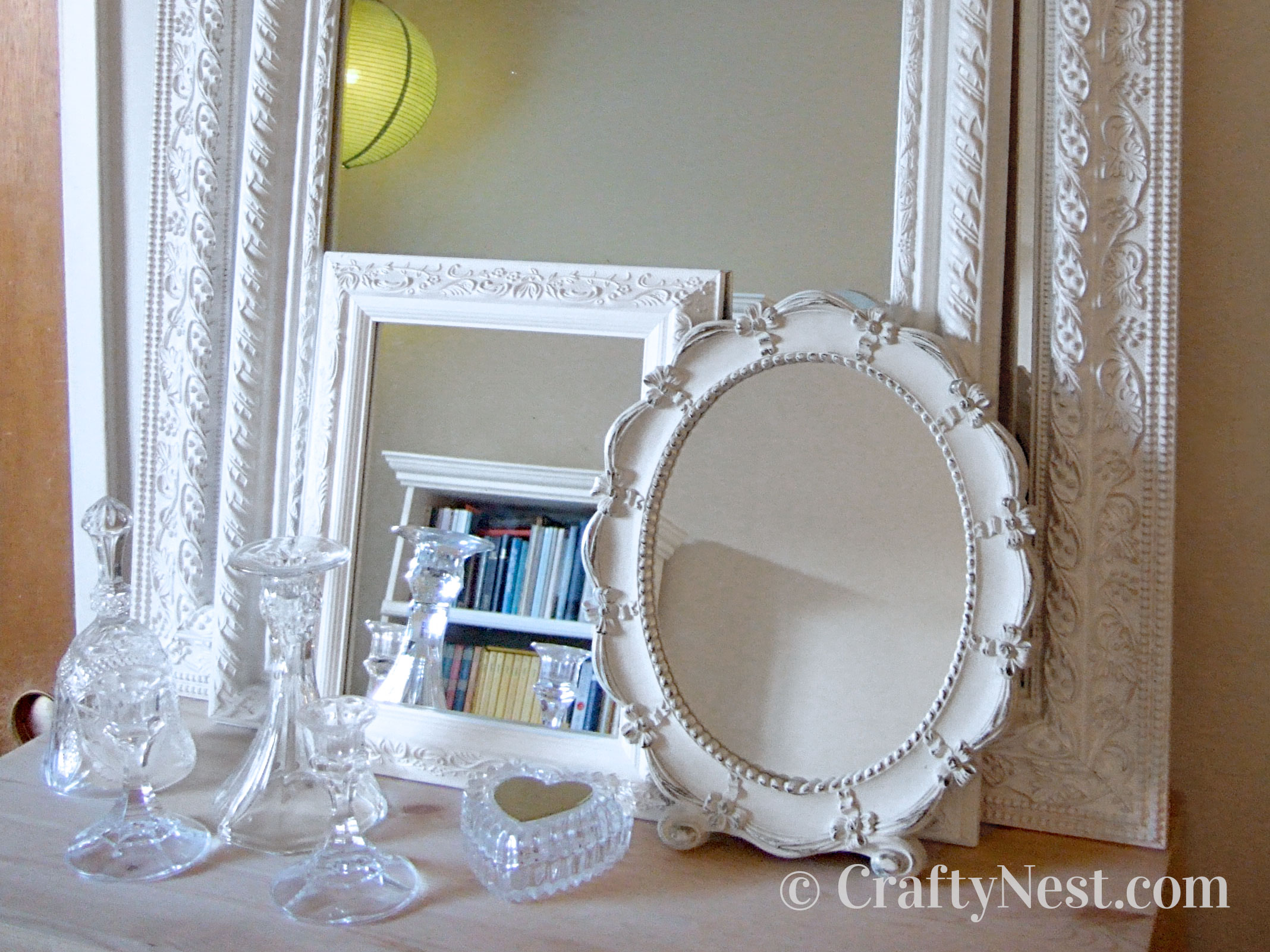 Stacked mirrors and crystal items, photo