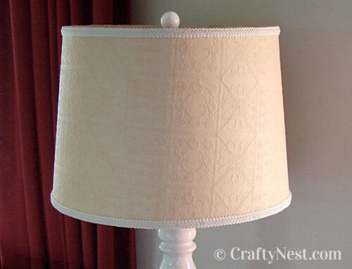 Fabric-covered lampshade & ball finial