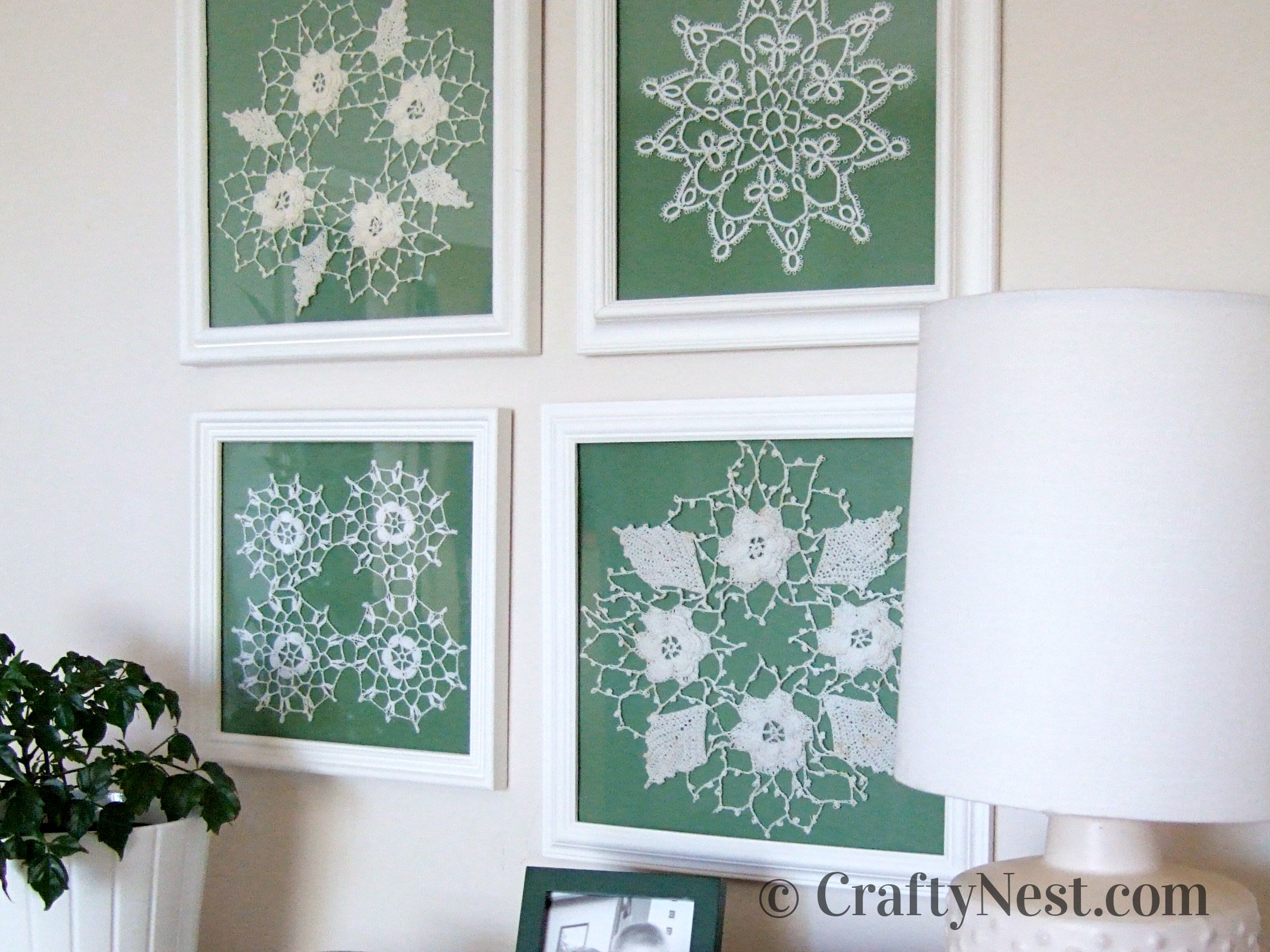 Tatted doilies in square white frames, photo
