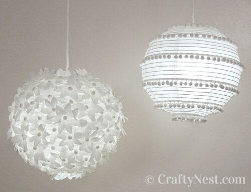 Two paper lanterns: flowers & pom poms