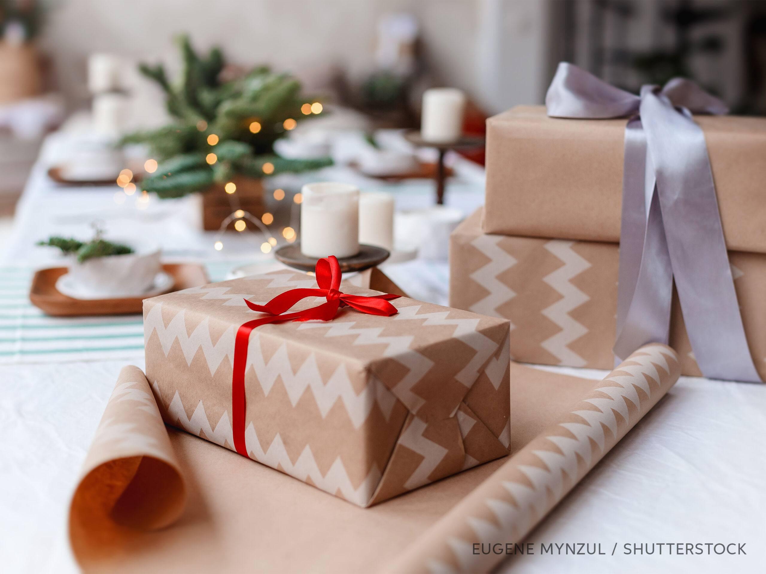 Wrapping presents on a holiday table, photo