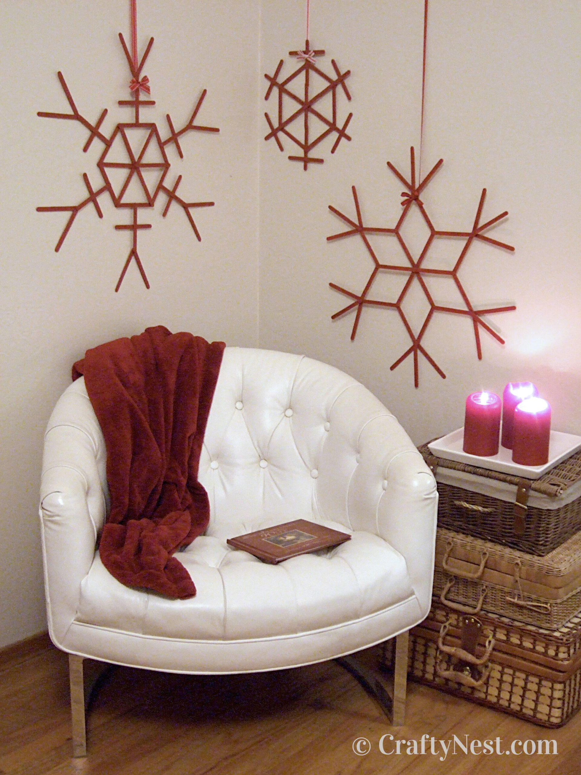 Red craft-stick snowflakes on wall, photo