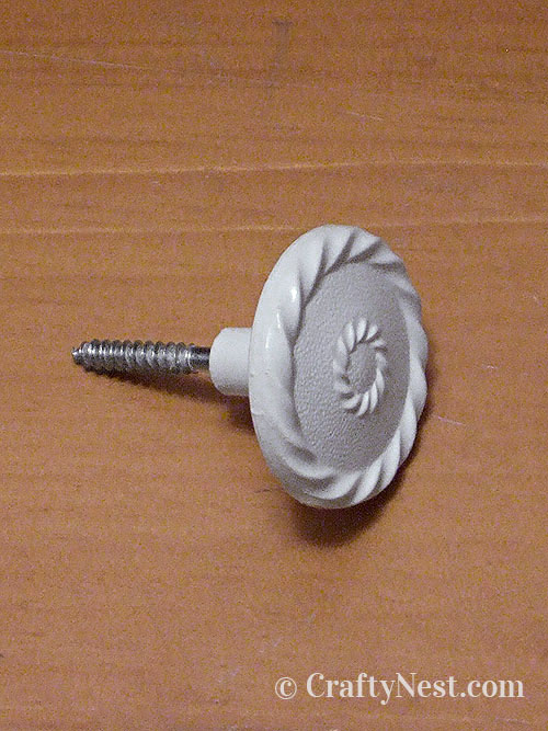 Insert hanger bolt in drawer pull, photo