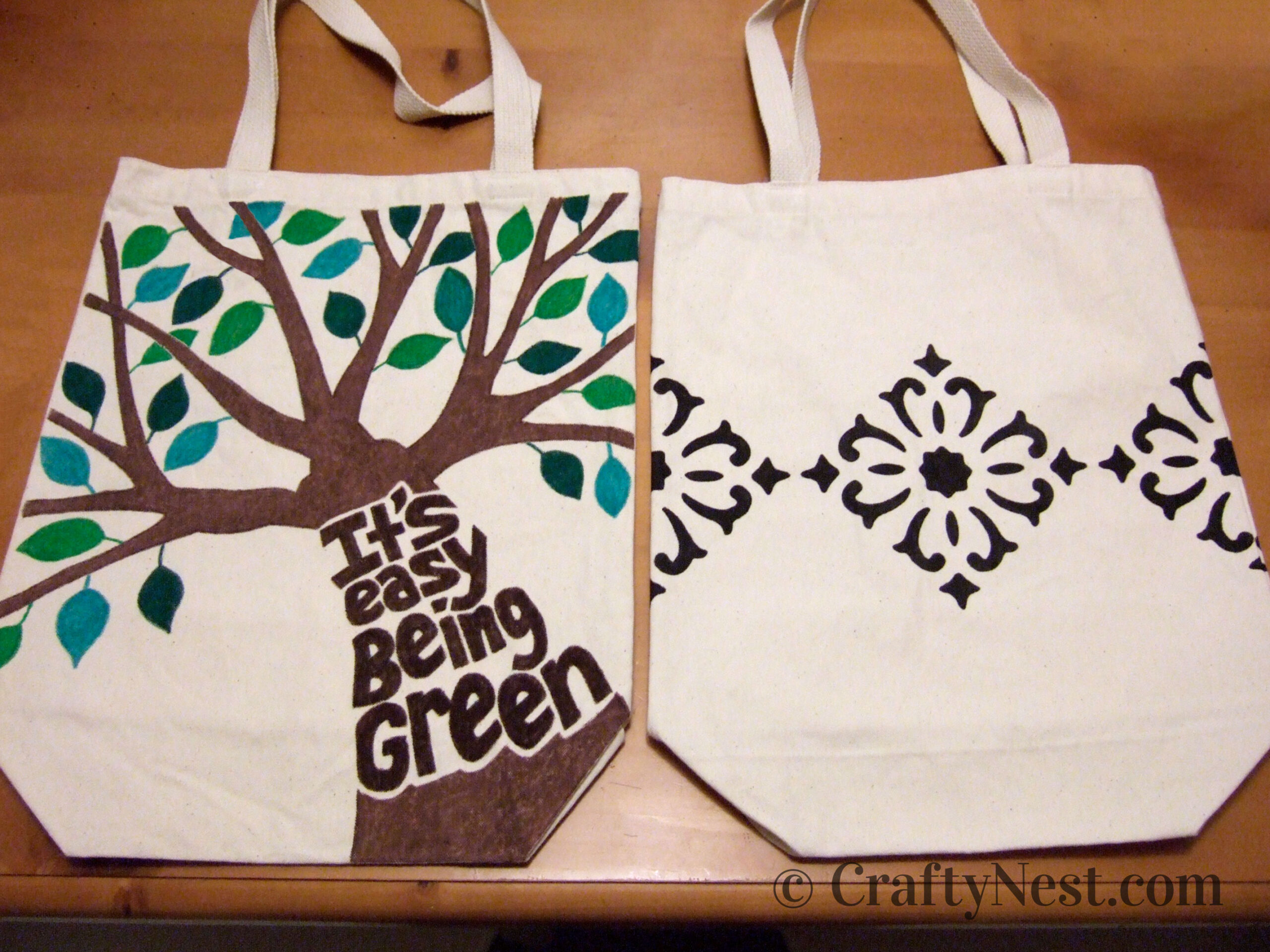 Canvas tote bags decorated with tree and diamond designs, photo