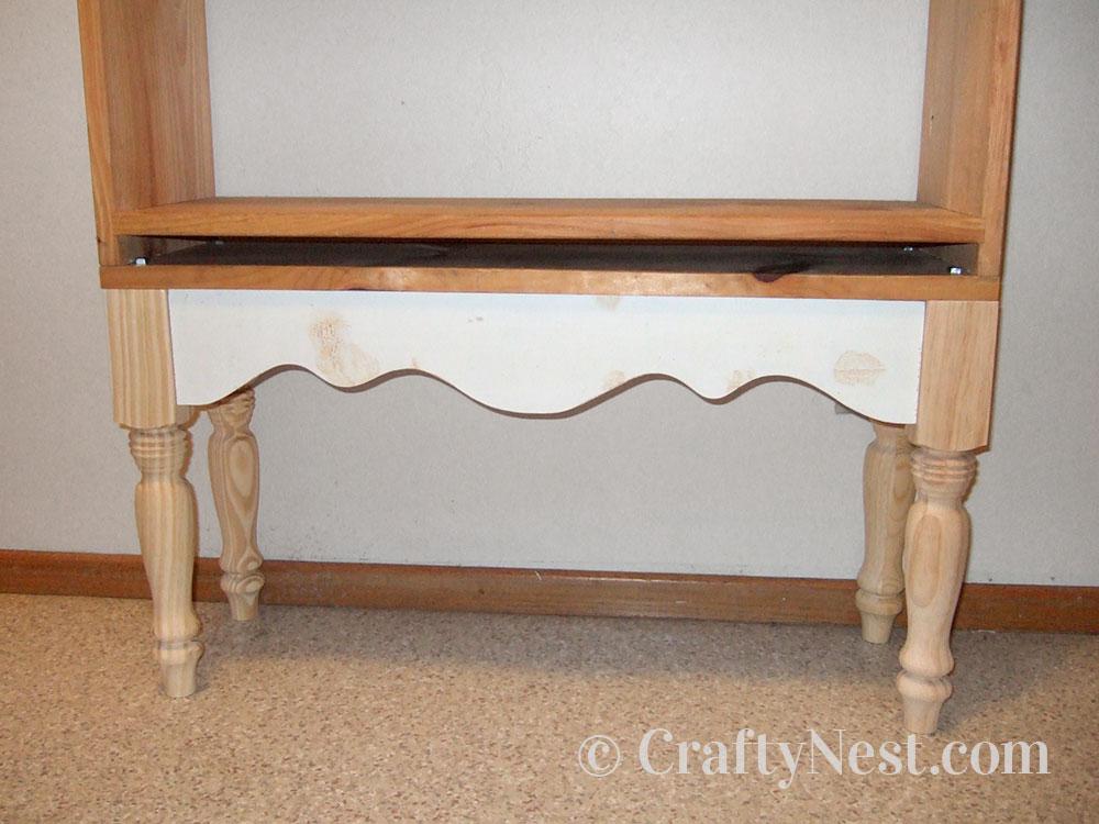 Place bookshelf onto table base, photo