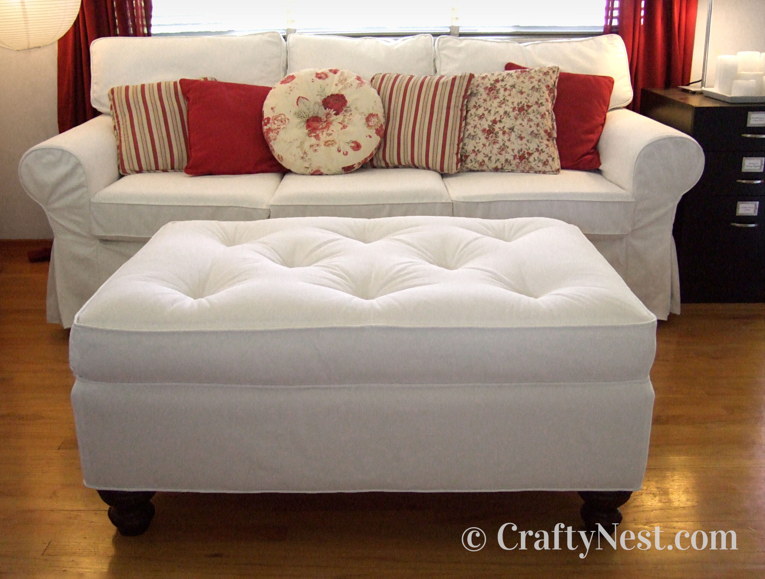 White tufted ottoman, photo