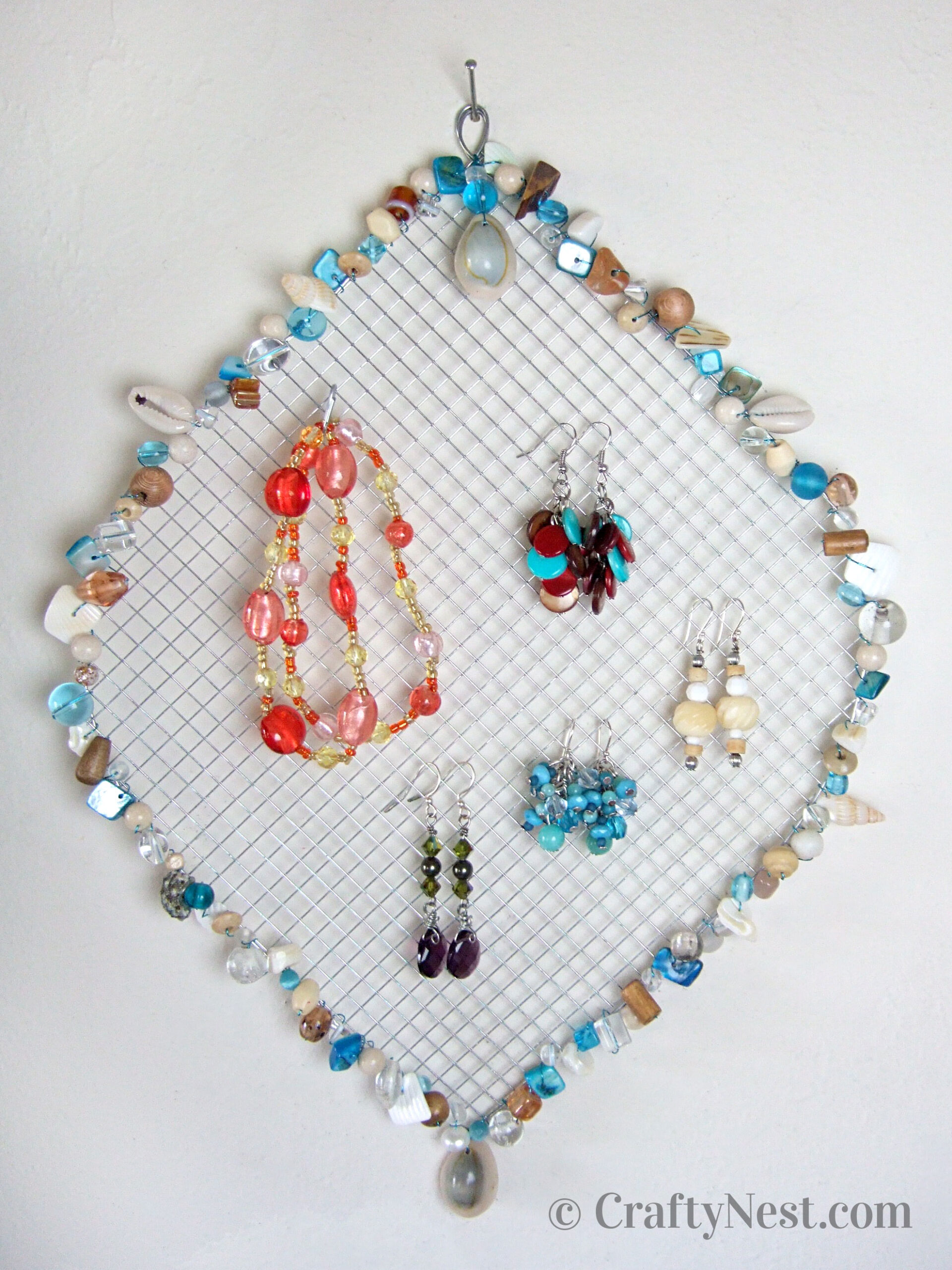 Wire mesh jewelry holder with beads, photo