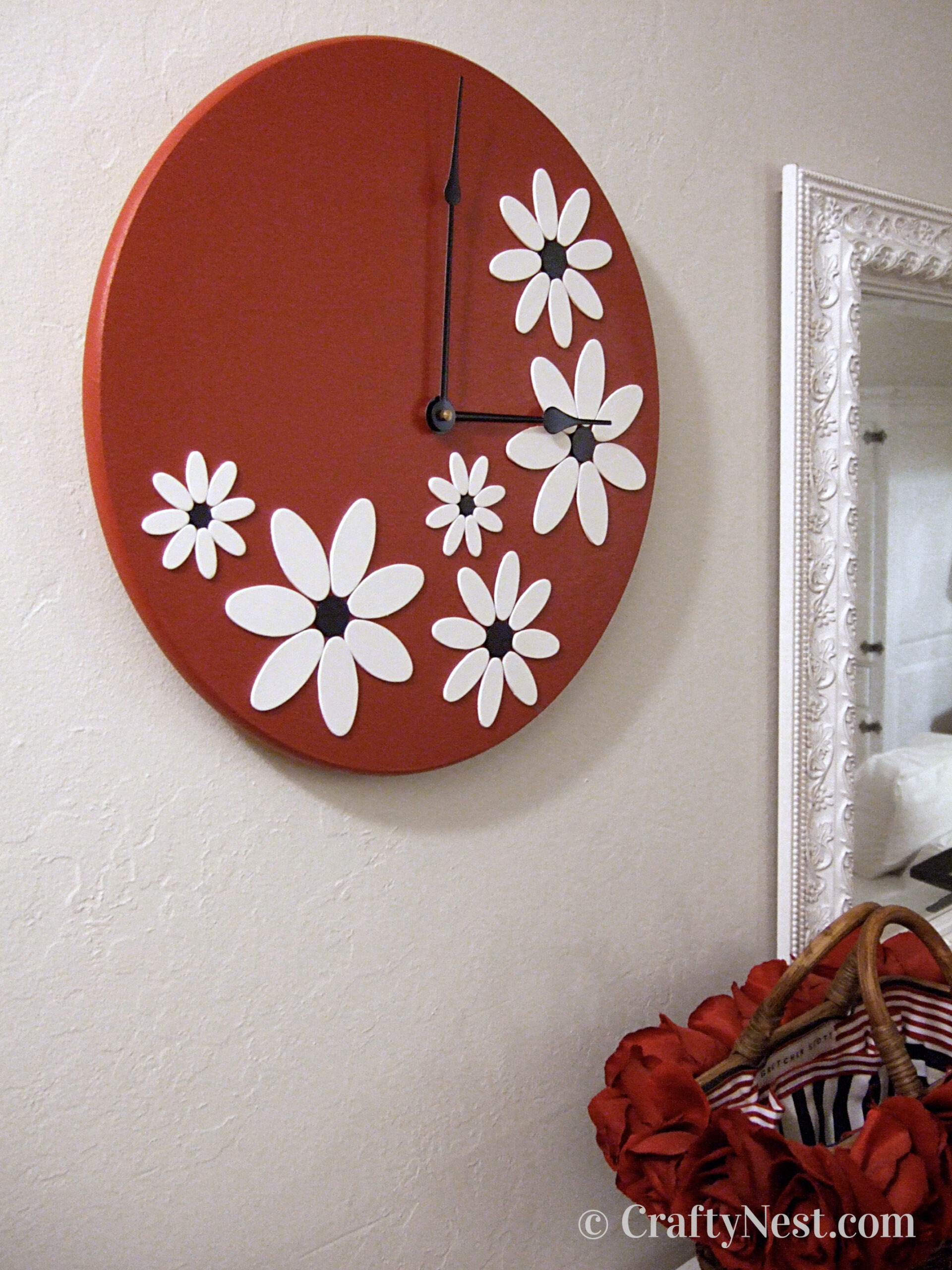 Big red clock with white flowers, photo