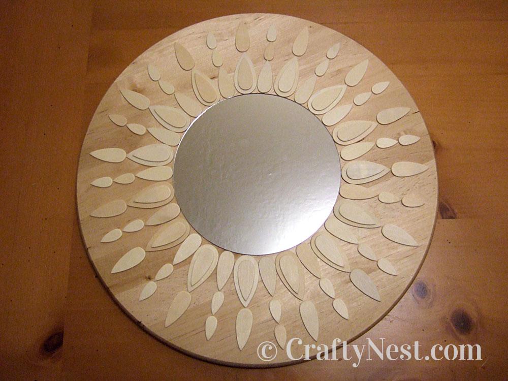 Unpainted sunburst mirror, photo