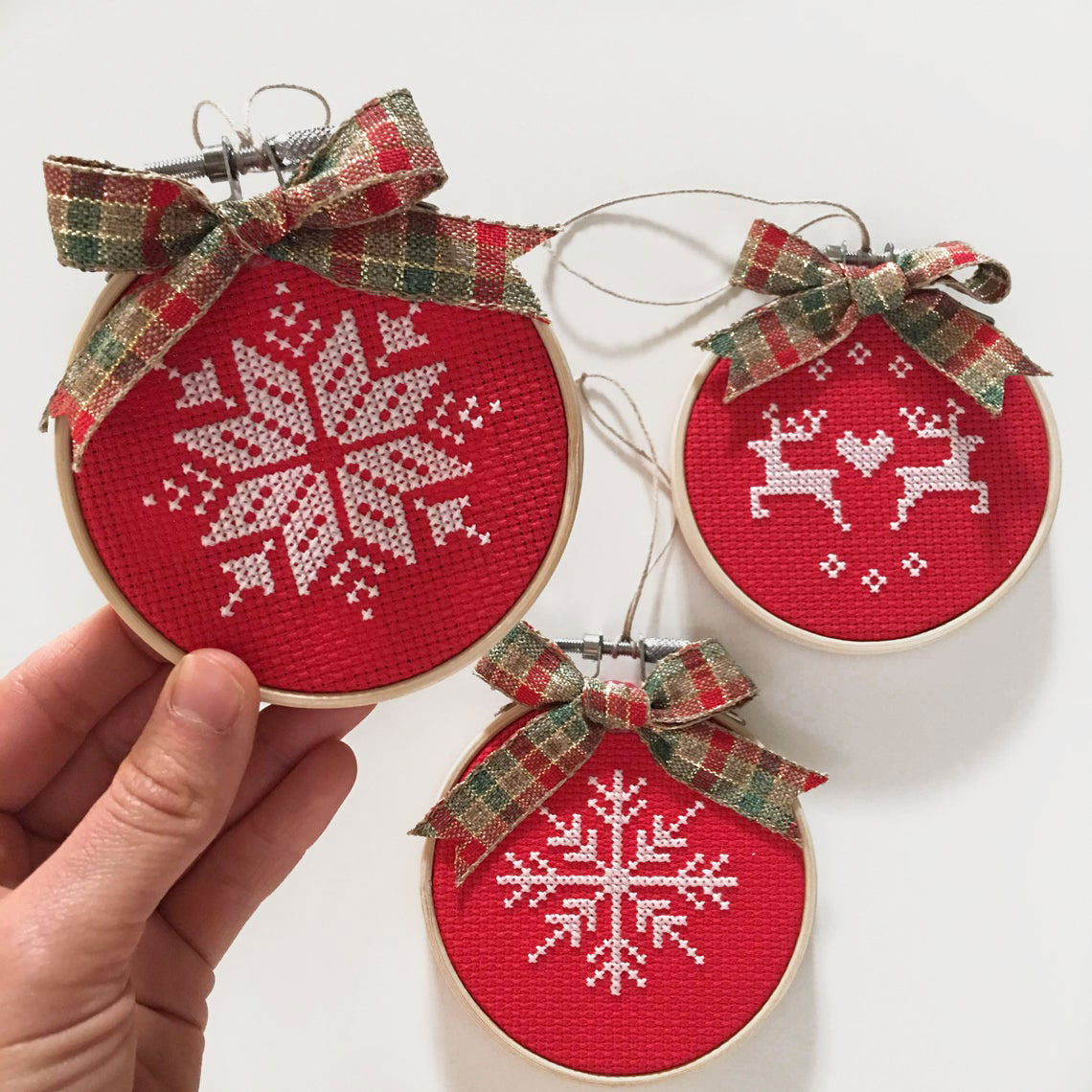 Cross stitch ornaments by The Nesting Needle, Etsy photo