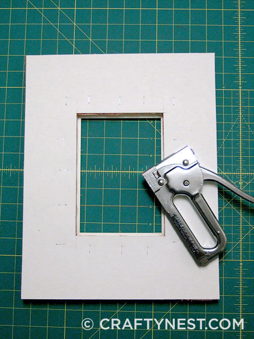 Staple cardboard to small frame, photo