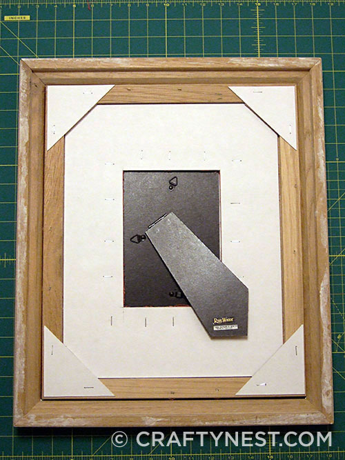 Assemble and staple the triangles to the frame, photo