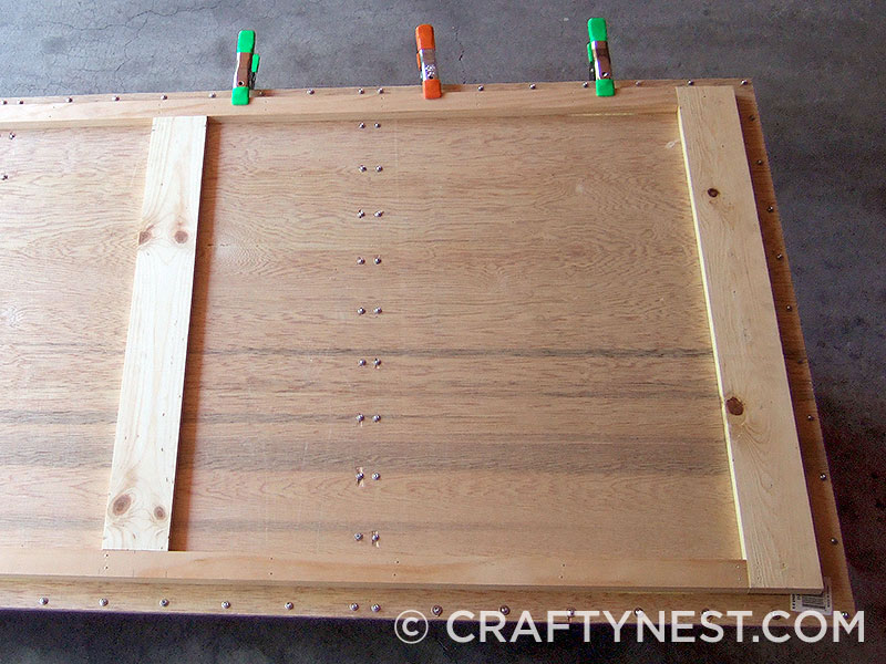 Clamp and glue the wood frame, photo