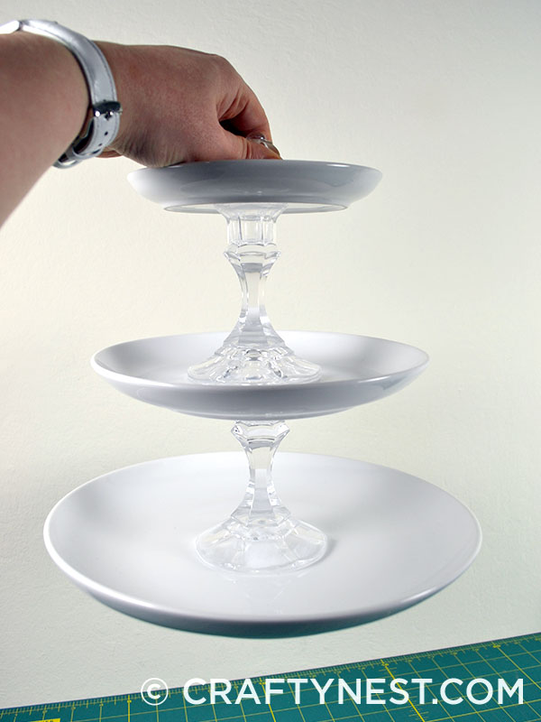 Holding the 3-tiered tray, photo