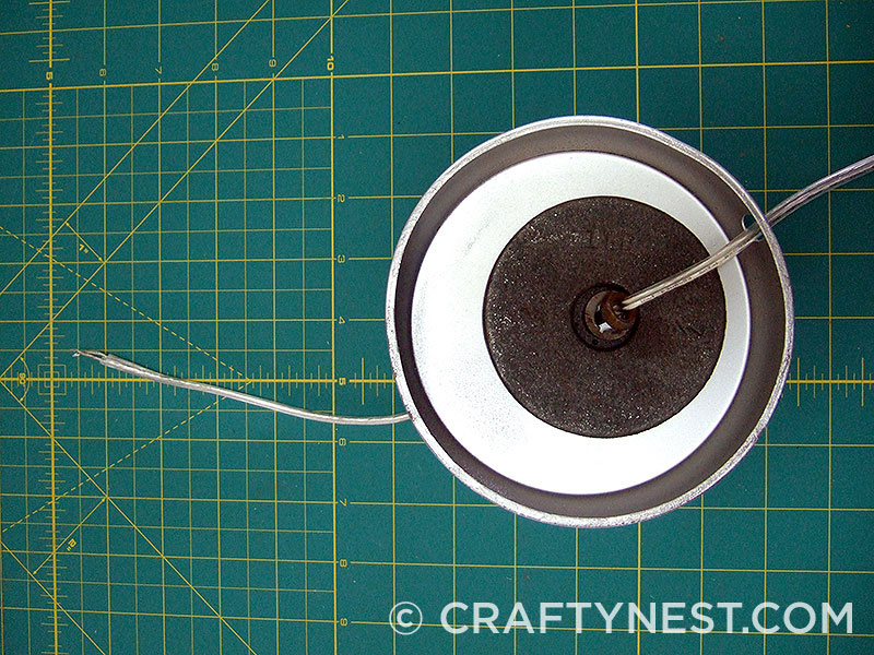 Feed the cord through the base, photo