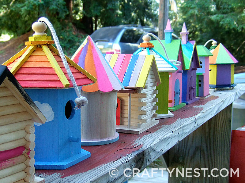 Row of birdhouses on a bench, photo