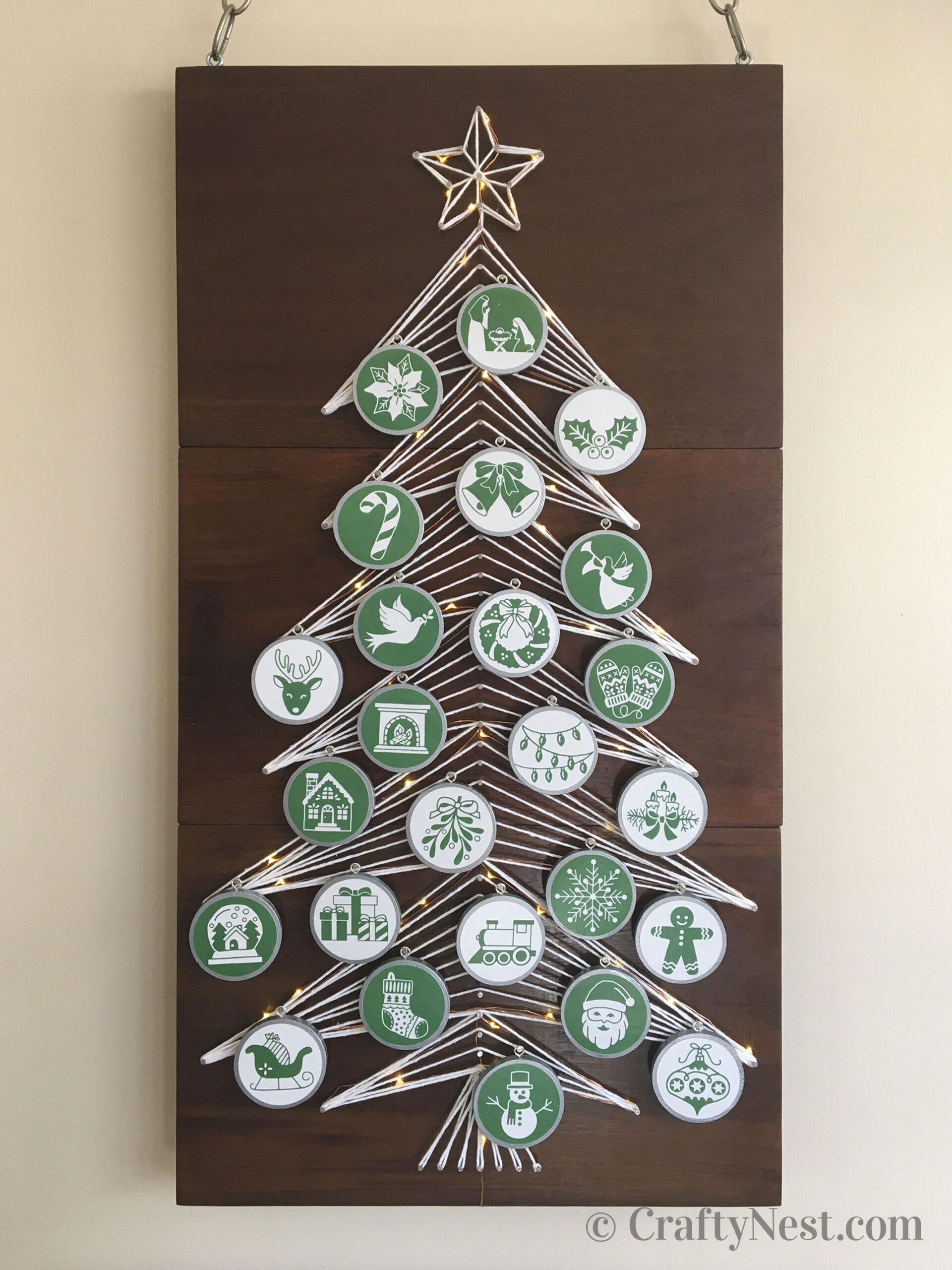 String art advent calendar Christmas tree with lights and ornaments, photo