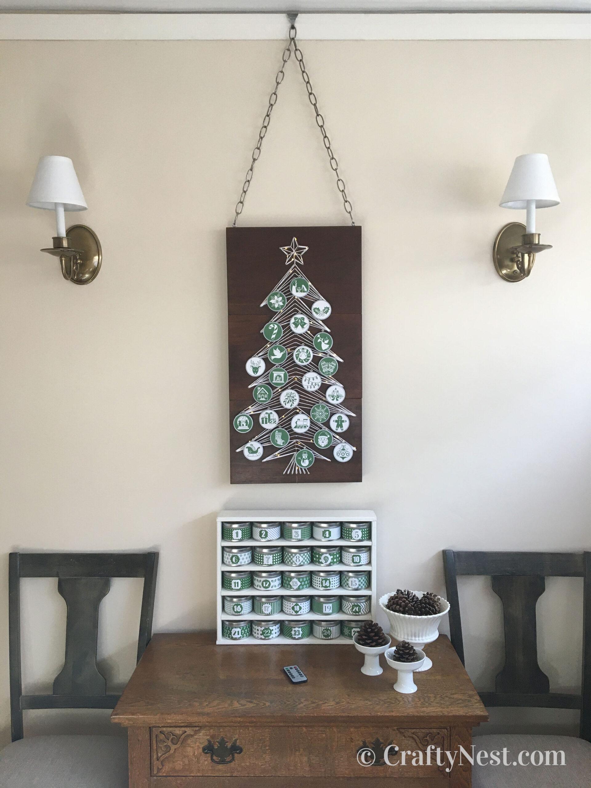 String art Christmas tree advent calendar, ornaments, and tins, photo