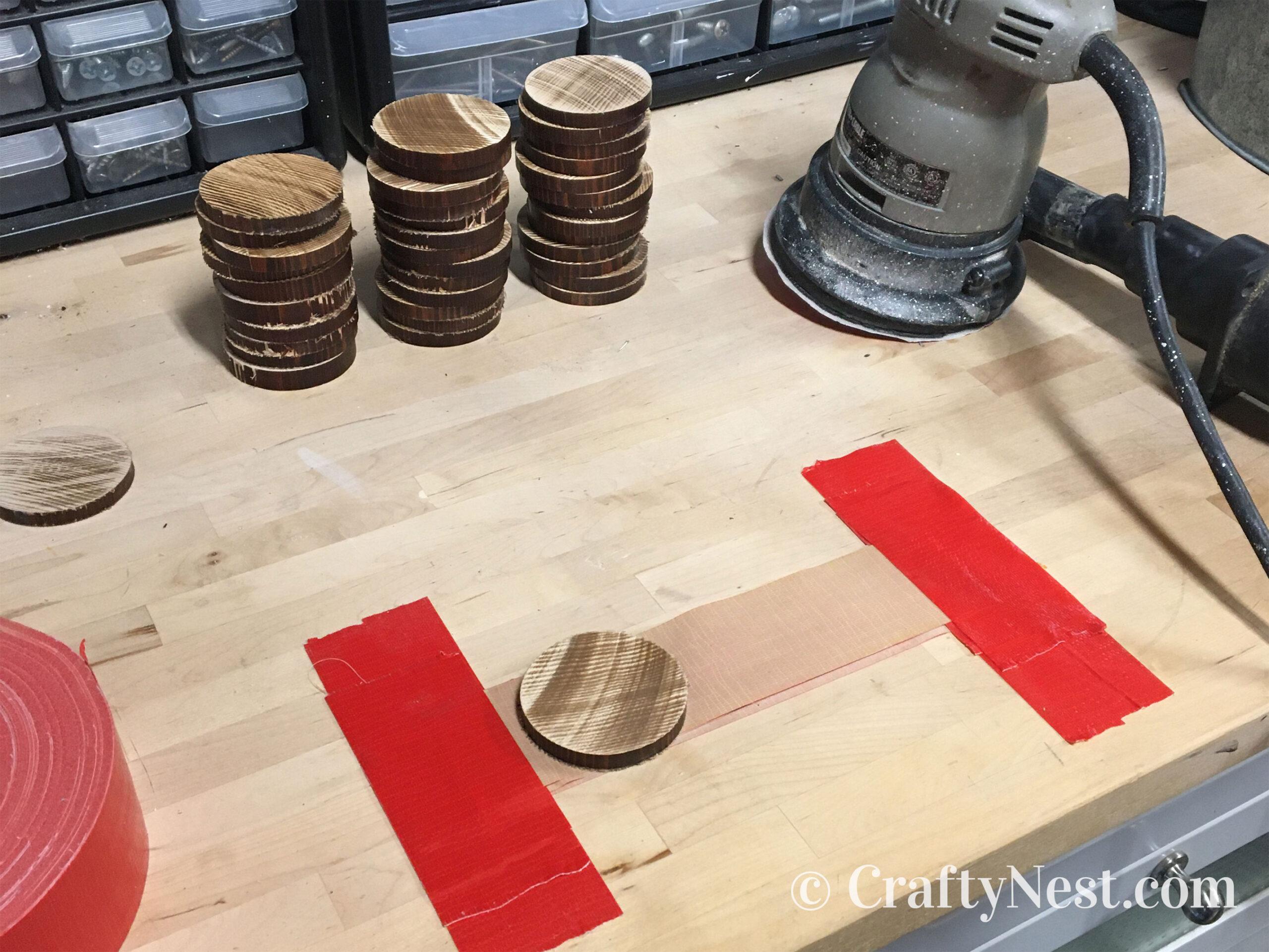 Sanding the dowel slices, photo