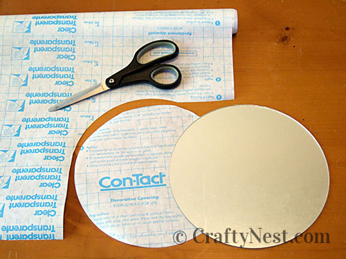Cover the mirror with Con-Tact Paper, photo